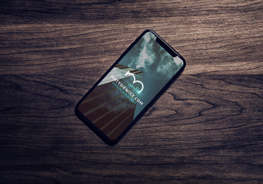 Free iPhone 8 on Table with Macbook and AirPods PSD Mockup
